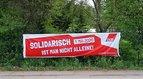Banner zum 1. Mai an der Rennbahn in Leipzig AKtion der IG Metall Jugend Leipzig